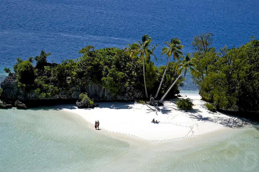 Aerial of three Coconut Island in Palau Micronesia