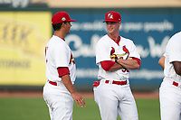 Palm Beach Cardinals Griffin Roberts (32) talks with Edgar Escobar (15) before a Florida State League game against the Clearwater Threshers on August 9, 2019 at Roger Dean Chevrolet Stadium in Jupiter, Florida.  Palm Beach defeated Clearwater 3-0 in the second game of a doubleheader.  (Mike Janes/Four Seam Images)