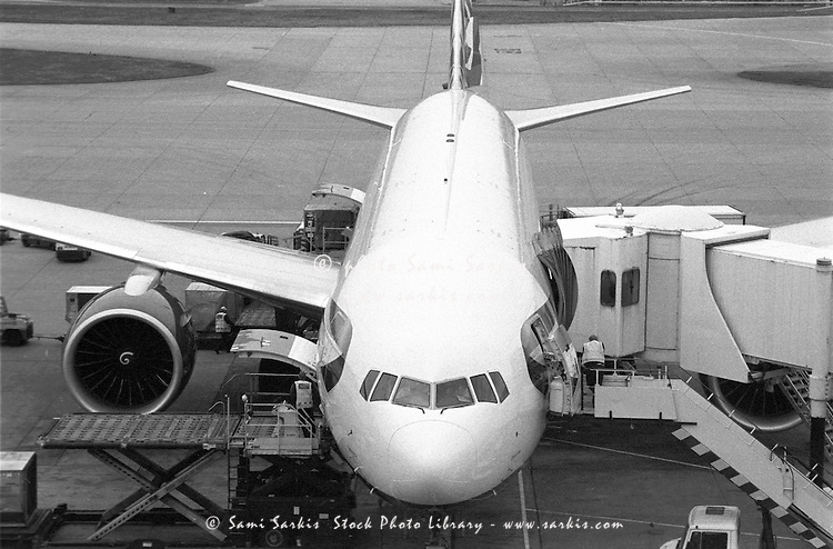 Airplane boarding on the runway.