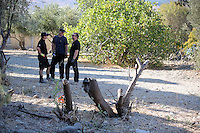 Pictured: Special forensics police officers take a small break before felling a tree after to make space for a further search by a disused building in a field in Kos, Greece. Saturday 01 October 2016<br /> Re: Police teams led by South Yorkshire Police, searching for missing toddler Ben Needham on the Greek island of Kos have moved to a new area in the field they are searching.<br /> Ben, from Sheffield, was 21 months old when he disappeared on 24 July 1991 during a family holiday.<br /> Digging has begun at a new site after a fresh line of inquiry suggested he could have been crushed by a digger.