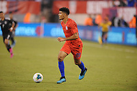 EAST RUTHERFORD, NJ - SEPTEMBER 7: Mile Robinson #22 of the United States kicks the ball during a game between Mexico and USMNT at MetLife Stadium on September 6, 2019 in East Rutherford, New Jersey.