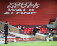 1st October 2020; Anfield, Liverpool, Merseyside, England; English Football League Cup, Carabao Cup, Liverpool versus Arsenal; Arsenal manager Mikael Arteta looks on under a giant banner on the Anfield Road stand