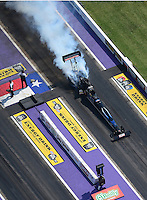 Apr. 28, 2012; Baytown, TX, USA: Aerial view of NHRA top fuel dragster driver David Grubnic during qualifying for the Spring Nationals at Royal Purple Raceway. Mandatory Credit: Mark J. Rebilas-
