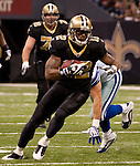 December 2009: New Orleans Saints wide receiver Marques Colston (12) runs with the ball during an NFL football game at the Louisiana Superdome in New Orleans.  The Cowboys defeated the Saints 24-17.