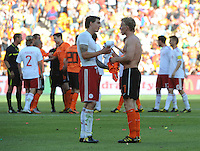 Holland's Dirk Kuyt and Denmark's Daniel Agger exchange jersiess, as is the traditional international soccer tradition to salute an opponent after the match. Holland defeated Denmark, 2-0, June 14th, at Soccer City in the opening match of Group E of the 2010 FIFA World Cup.