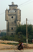 "A European ""tower"" near Kaiping city in Guangdong Province, China. The European style ""towers"" were built by .overseas Chinese returning with architectural ideas from America and Europe. ."