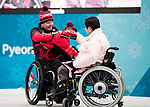 PyeongChang 7/3/2018 - Team Canada is welcomed into the athletes' village during the Team Welcome Ceremony and flag raising ahead of the 2018 Winter Paralympic Games in PyeongChang, Korea.  Todd Nicholson exchanges gifts with athletes' village mayor Park Eun-soo.  Photo: Dave Holland/Canadian Paralympic Committee