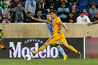 HARRISON, NJ - MARCH 11: Anton Tinnerholm #3 of NYCFC crosses the ball past Jesus Duenas #29 of Tigres UANL during a game between Tigres UANL and NYCFC at Red Bull Arena on March 11, 2020 in Harrison, New Jersey.