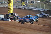 Dec. 11, 2011; Chandler, AZ, USA;  LOORRS pro 2 driver Robby Woods (99) and Todd LeDuc (4) during the Lucas Oil Challenge Cup at Firebird International Raceway. Mandatory Credit: Mark J. Rebilas-