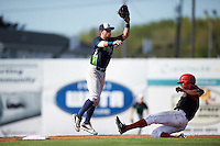 Vermont Lake Monsters second baseman Trace Loehr (6) jumps for a high throw as Stone Garrett (11) slides in during a game against the Batavia Muckdogs August 9, 2015 at Dwyer Stadium in Batavia, New York.  Vermont defeated Batavia 11-5.  (Mike Janes/Four Seam Images)