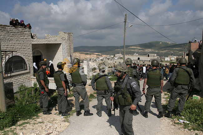 Israeli troops arrive to break up a scuffle between Jewish settlers and Palestinians in the West Bank village of Aseera, Saturday, April 9, 2011. Palestinian witnesses said about 40 settlers entered the village and scuffled with residents, until Israeli troops intervened and forced the settlers out. Photo by Wagdi Eshtayah