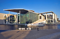 Germany, Berlin.  Bundestag.  Marie-Elisabeth Lueders-haus.  Part of the new government complex Spreebogen near the Reichstag.  Tourist sightseeing boat on the River Spree and crosses to victims of the Berlin Wall.