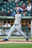 Casey Gillaspie (16) of the Durham Bulls follows through on his swing against the Charlotte Knights at BB&T BallPark on May 15, 2017 in Charlotte, North Carolina. The Knights defeated the Bulls 6-4.  (Brian Westerholt/Four Seam Images)