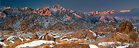902000026 panoramic winter dawn with snow covered granite boulders in the bureau of land management protected land the alabama hills in the southern section of the eastern sierras with lone pine peak mount whitney and mount russell in the background in kern county california