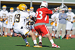 Baltimore, MD - March 3:  Long stick midfielder Nathan Klein #19 of the UMBC Retrievers  defends Midfielder Nick Tandoi #23 of the Fairfield Stags during the Fairfield v UMBC mens lacrosse game at UMBC Stadium on March 3, 2012 in Baltimore, MD.