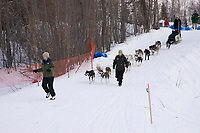Volunteers help Silvia Willis park her team at Galena on Saturday afternoon during the 2008 Iditarod