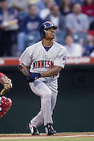 Jacque Jones of the Minnesota Twins bats during a 2002 MLB season game against the Los Angeles Angels at Angel Stadium, in Anaheim, California. (Larry Goren/Four Seam Images)