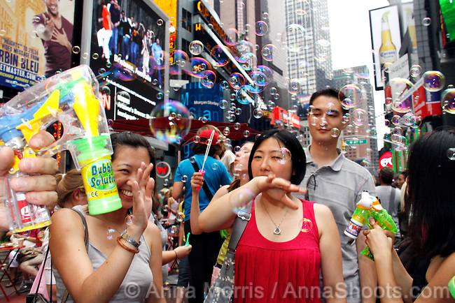 With all the crime and corruption in this city, it's nice to know that sometimes all you need is a flash mob armed with soapy water to brighten your day. Brought to you by the same folks responsible for the Union Square Pillow Fight, Newmindspace, Bubble Battle NYC 2010 gathered at Father Duffy Square on June 27th with bubble toys, bubble guns and plenty of bubble solution to launch a harmless attack on the city.