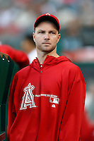 Ryan Madson #46 of the Los Angeles Angels, who has been on the disabled list all season, watches from the dugout a game against the St. Louis Cardinals at Angel Stadium on July 3, 2013 in Anaheim, California. (Larry Goren/Four Seam Images)