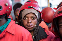 Members of the Red Ants prepare to enter Fatti's Mansions, a squatted building on Jeppe Street in the Johannesburg CBD.  The Red Ants are a controversial private security company often hired to clear squatters from land and so-called 'hijacked' properties.
