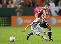 CARSON, CA - October 16, 2011: LA Galaxy midfielder Paolo Cardozo (30) and Chivas USA defender Zarek Valentin (20) during the match between LA Galaxy and Chivas USA at the Home Depot Center in Carson, California. Final score LA Galaxy 1, Chivas USA 0.