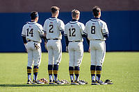 Michigan Wolverines infielders Christian Molfetta (14), Benjamin Sems (2), Riley Bertram (12) and Jimmy Obertop (8) stand for the national anthem before the NCAA baseball game against the Illinois Fighting Illini at Fisher Stadium on March 19, 2021 in Ann Arbor, Michigan. Illinois won the game 7-4. (Andrew Woolley/Four Seam Images)
