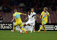 Thursday 27 February 2014<br /> Pictured: Wayne Routledge of Swansea (C) against Gokhan Inler (L) and Valon Behrami (R) of Napoli<br /> Re: UEFA Europa League, SSC Napoli v Swansea City FC at Stadio San Paolo, Naples, Italy.