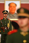 The guards of Chinese People's Armed Police Force guard in Tian An Men Square with Mao Zedong's portrait in the background. Beijing. China
