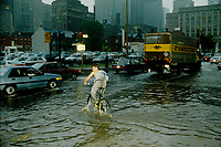 Innondation du 14 juillet 1987.<br /> <br /> <br /> <br /> <br /> <br /> <br /> July 14, 1987 File Photo - Montreal (Qc) CANADA  -  Cars and people during One of montreal worst flood.<br /> <br /> The Montreal Flood of 1987 happened on July 14 of that year when a series of strong thunderstorms crossed the island of Montreal, Canada, between the noon hour and 2:30 p.m. Over 100 mm of rain fell during this very short period of time. The sewer systems were overwhelmed by the deluge and the city was paralyzed by the flooded roads. Autoroute 15, a sunken highway also known as the Decarie Expressway, soon filled with water trapping motorists. Some 350,000 houses lost electricity, and tens of thousands had flooded basements. Two people died, one in a submerged car and another who was electrocuted