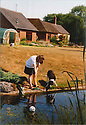 Collect photo from 1995<br /> <br /> John's friend Anna Anderson with his dog Daisy.<br /> <br /> <br /> All Rights Reserved: F Stop Press Ltd. +44(0)1773 550665   www.fstoppress.com 27/10/16<br /> <br /> You'd be forgiven for thinking that after more than 50 years running a garden nursery, 67-year-old John Massey would be enjoying the peace and tranquillity of retirement.<br /> <br /> But not a bit of it, if anything this keen plantsman is now busier than ever, caring for his own three-acre garden, a beautiful 'all seasons' oasis set in the heart of industrial Birmingham.<br /> <br /> Full story: https://fstoppressblog.wordpress.com/birmingham-garden-in-stunning-autumn-colour/<br /> <br /> With its informal borders, island beds, woodland dells and wildlife meadow, the garden is a riot of colour still, despite the colder evenings and fading daylight hours, showing off an abundance of rare plants as well as many familiar favourites including cyclamen and colchicums, malus trees laden with crab apples and the fiery hues of liquidambar, euonymus and Japanese acers.<br /> <br /> MORE…<br /> <br /> All Rights Reserved: F Stop Press Ltd. +44(0)1773 550665 www.fstoppress.com