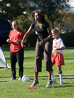 Michelle Obama, Rachel Buehler. Michelle Obama hosted a Lets Move! soccer clinic held on the South Lawn of the White House assisted by members of the USWNT.  Let's Move! was started by Mrs. Obama as a way to promote a healthier lifestyle in children across the country.