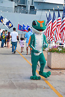 An interpreter is costumed as Hawai'i's beloved gecko at the battleship USS Missouri on Ford Island, Pearl Harbor, O'ahu.