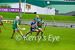 Crotta's Tomas O'Connor in possession as he clears his defence as Brend án O'Connor gives chase in the County Senior Hurling Championship quarter final