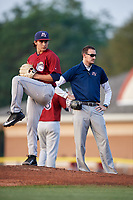Mahoning Valley Scrappers trainer Jake Legan observes starting pitcher Elijah Morgan (43) during a game against the Batavia Muckdogs on August 30, 2017 at Dwyer Stadium in Batavia, New York.  Batavia defeated Mahoning Valley 5-1.  (Mike Janes/Four Seam Images)