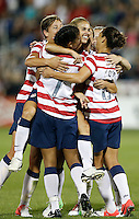 Commerce City, Colorado - Wednesday September 19, 2012; The US WNT defeated the National team of Australia 6-2 during an International friendly game at Dick's Sporting Goods Park.  Teammates congratulate Heather Mitts (2) on her assist on an Alex Morgan (13) goal on a header against Australia.