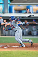Jose Maria (24) of the Kingsport Mets follows through on his swing against the Burlington Royals at Burlington Athletic Stadium on July 18, 2016 in Burlington, North Carolina.  The Royals defeated the Mets 8-2.  (Brian Westerholt/Four Seam Images)