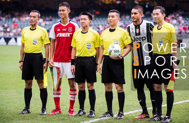 South China's player Chan Wai Ho (2nd l) and Juventus' player Roberto Pereyra (2nd r) pose for a pictures with the referees before the South China vs Juventus match of the AET International Challenge Cup on 30 July 2016 at Hong Kong Stadium, in Hong Kong, China.  Photo by Marcio Machado / Power Sport Images