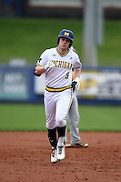 Michigan Wolverines infielder Travis Maezes (9) runs the bases after hitting a home run during the first game of a doubleheader against the Siena Saints on February 27, 2015 at Tradition Field in St. Lucie, Florida.  Michigan defeated Siena 6-2.  (Mike Janes/Four Seam Images)