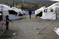 Pictured: A woman and child at the Schisto camp site Friday 26 February 2016<br />Re: Hundreds of refugees have been given temporary shelter at the Stefanakis Army Camp in the Schisto area of Athens, Greece.