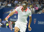 Roger Federer (SUI) goes up in the first set against Stanislas Wawrinka (SUI) 6-4 at the US Open in Flushing, NY on September 11, 2015.