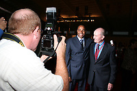 Arkansas Democrat-Gazette/BOBBY AMPEZZAN<br /><br />TRIBUTE 0928 NWProfiles 1.JPG<br />Olympic gold medalist Mike Conley poses with his former track coach, John McDonnell, in the media circle.<br /><br />9-18-08