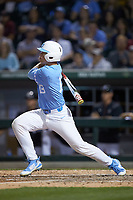 Clemente Inclan (18) of the North Carolina Tar Heels follows through on his swing against the South Carolina Gamecocks at BB&T BallPark on April 3, 2018 in Charlotte, North Carolina. The Tar Heels defeated the Gamecocks 11-3. (Brian Westerholt/Four Seam Images)