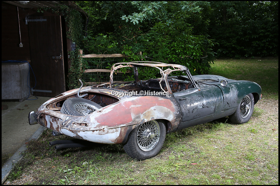 BNPS.co.uk (01202 558833)Pic: Historics/BNPS<br /> <br /> The tires were removed before the freak fire left the classic E-type Jaguar in tatters.<br /> <br /> Hot wheels...<br /> <br /> A vintage E-type Jaguar has been put up for sale for £32,000 after a freak fire during a respray left it in tatters.<br /> <br /> The classic open top caught fire after its fuel leaked and came into contact with sparks created by welding.<br /> <br /> It had been with its owner since 1986 but but he has now seen his classic vehicle completely ruined.<br /> <br /> It is thought he had been contemplating a respray for some time before finally making the decision to go through with the work.<br /> <br /> The disaster occurred as the team of mechanics were disassembling the Jaguar ready to paint, when when one of them accidentally cut through its fuel line.