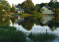 Calm waters of Academy Cove reflect Wickford's historic houses.