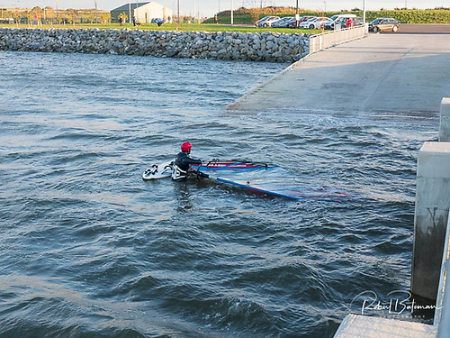 Even in Winter, the Paddy's Point slipway is in use, with a Cork Harbour windsurfer coming ashore