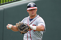 Catcher Ryan Query (25) of the Rome Braves, an Atlanta Braves affiliate, in a game against the Greenville Drive on July 8, 2012, at Fluor Field at the West End in Greenville, South Carolina. Greenville won, 12-3. (Tom Priddy/Four Seam Images)