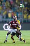 AC Milan Forward MBaye Niang (L) fights for the ball with Borussia Dortmund Defender Lukasz Piszczek (R) during the International Champions Cup 2017 match between AC Milan vs Borussia Dortmund at University Town Sports Centre Stadium on July 18, 2017 in Guangzhou, China. Photo by Marcio Rodrigo Machado / Power Sport Images