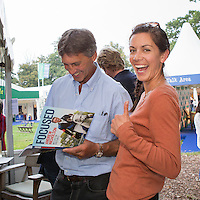 Darnelle Price gets a book signed for her Mother: NZL-Andrew Nicholson BOOK LAUNCH - FOCUSED: Published by The Racing Post: 2014 GBR-Land Rover Burghley Horse Trial (Friday 5 September) CREDIT: Libby Law COPYRIGHT: LIBBY LAW PHOTOGRAPHY - NZL