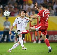 Michael Ballack of Germany in action against Radoslaw Sobolewski of Poland at FIFA World Cup Stadium, Dortmund, Germany, June 14, 2006.