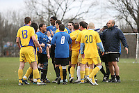 Trouble flares at Hackney Marshes between players of Real Romania FC (yellow) and OKJH FC - 22/02/09 - MANDATORY CREDIT: Gavin Ellis/TGSPHOTO - Self billing applies where appropriate - Tel: 0845 094 6026